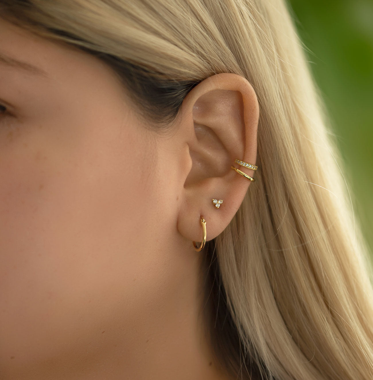 Curated Ear with Small Gold Hoop Earrings, Clover Stud Earring, Eternity and Pave Ear Cuff