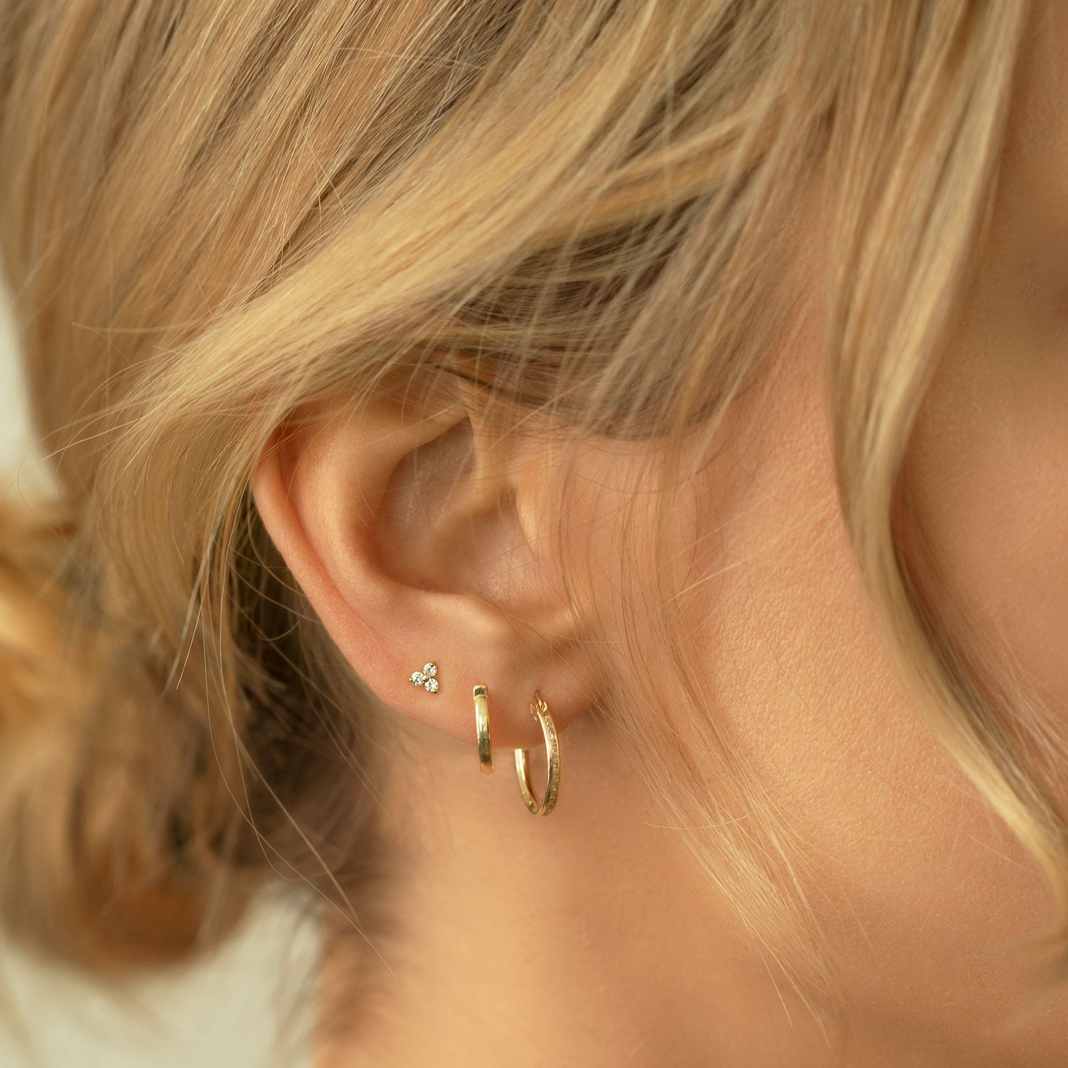 caption: Model wearing 6.5mm on second hole