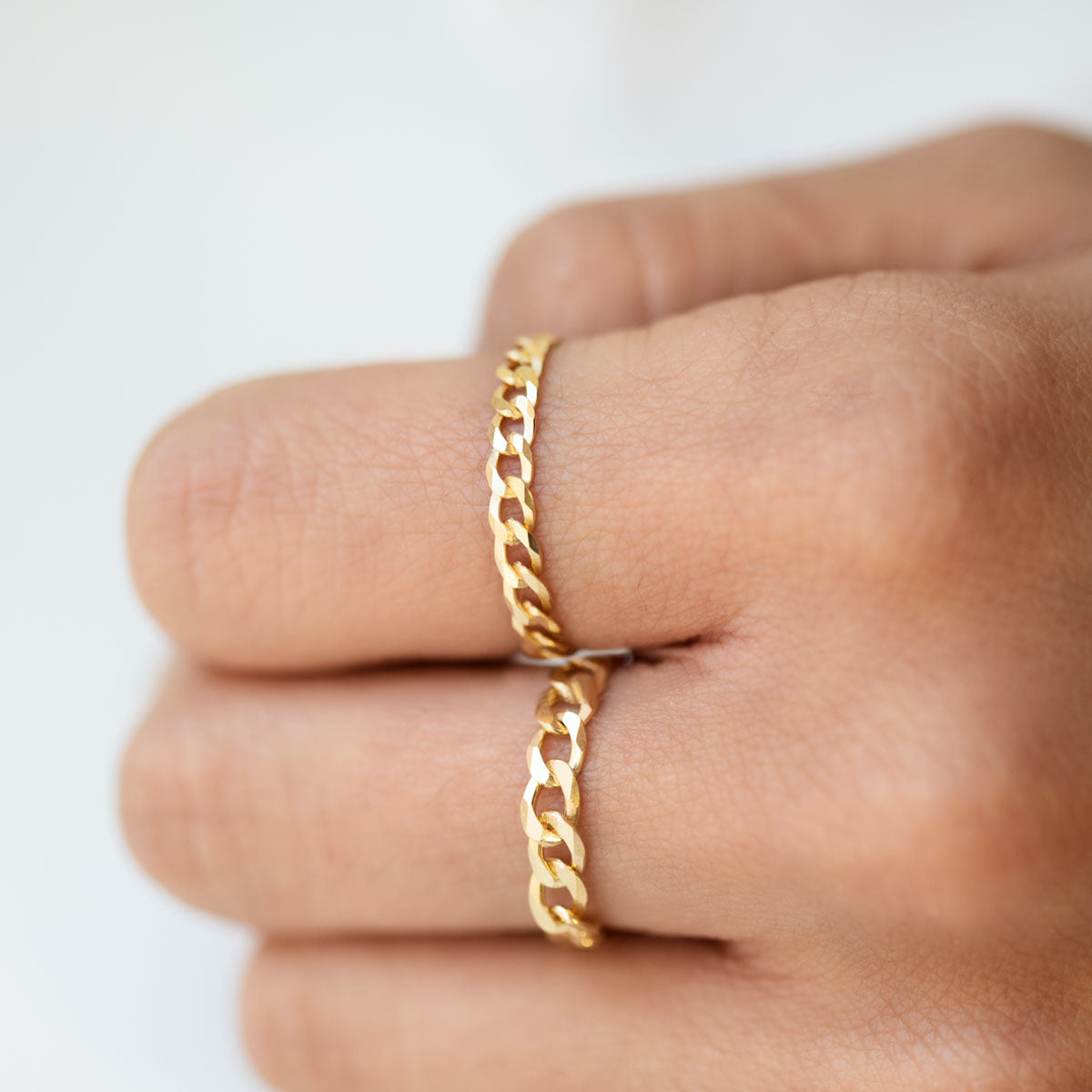 Gold Curb Chain Rings worn on Index and Middle Finger