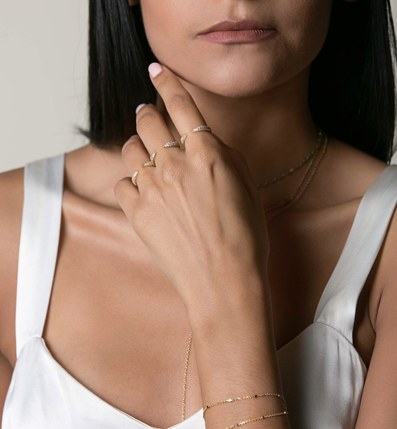 Model wearing a set of three Gold Claw Pave Rings