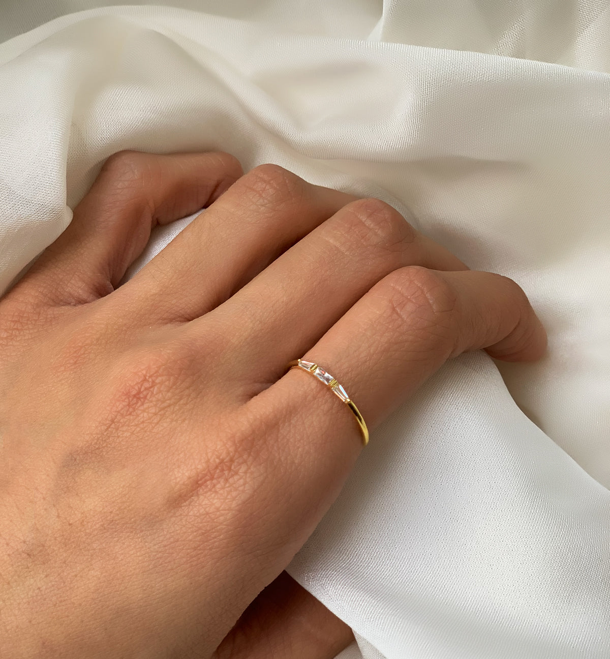 Simple and Dainty Gold Baguette Ring worn on Index Finger