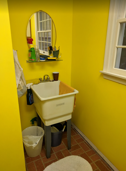 The bright yellow walls and brick print linoleum weren't the vision Chris and Stacey had in mind. The functional laundry sink was great, but the unfinished look left a lot to be desired. With an active family, they also wanted to add a bench and cubby for additional storage and make the most of the space.