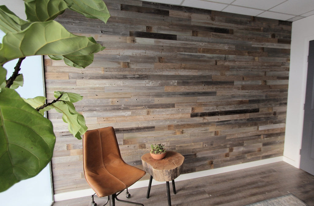 Reclaimed barn wood planks for walls. DIY reclaimed barn wood wall.