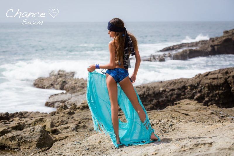 Girl looking at the waves crash wearing the Blue Currents Tween Girl Tankini Set - Chance Loves Swimwear