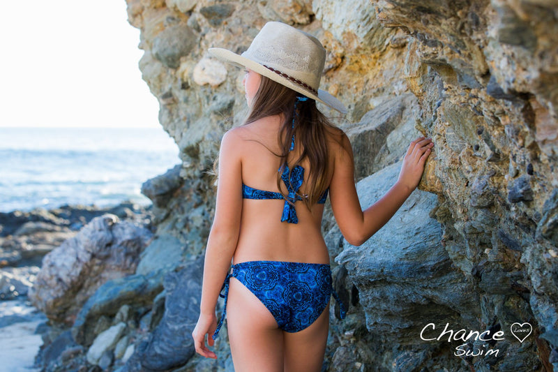 Girl Exploring the Coves wearing the Blue Currents Tween Girl Tankini Set - Chance Loves Swimwear
