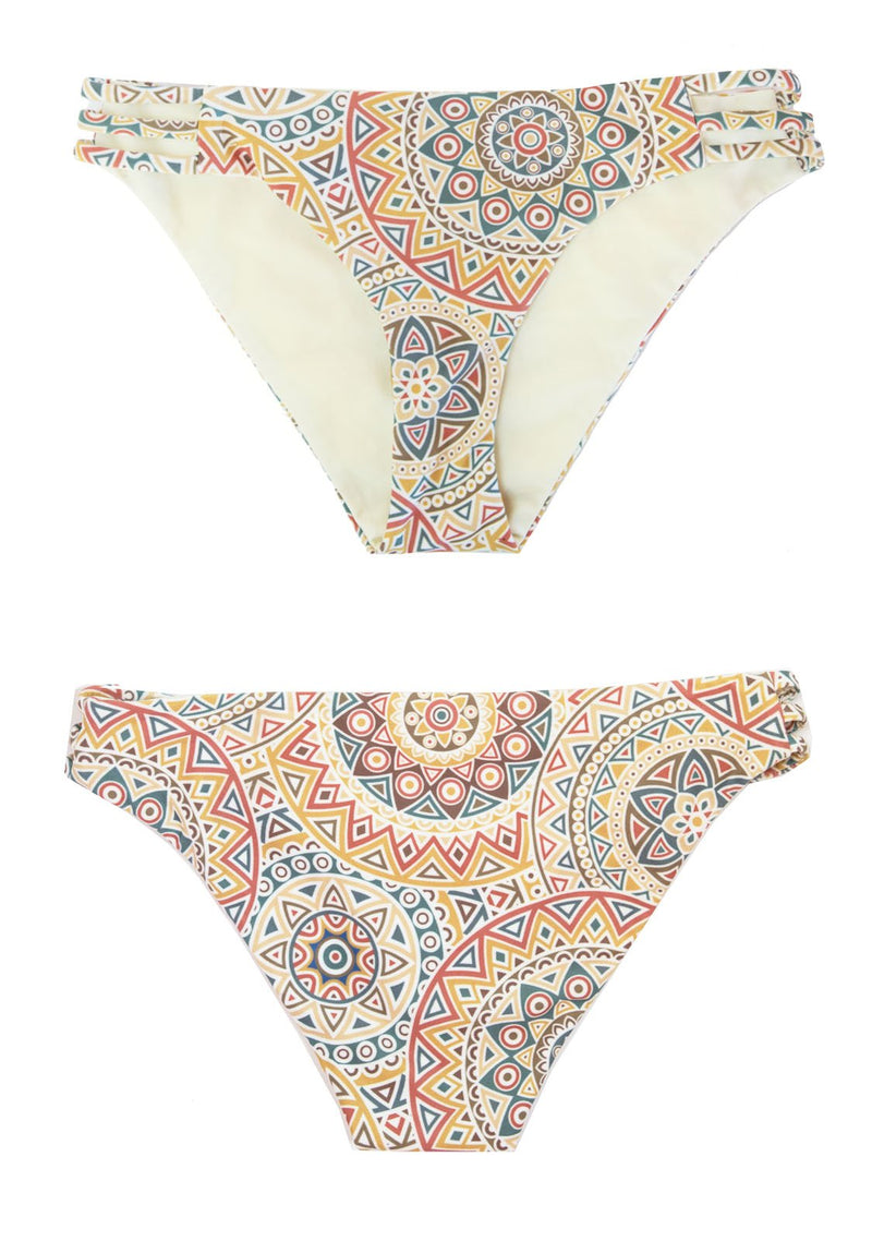 Classic Bikini Bottoms with a reversible solid light yellow side, and a mandala print.