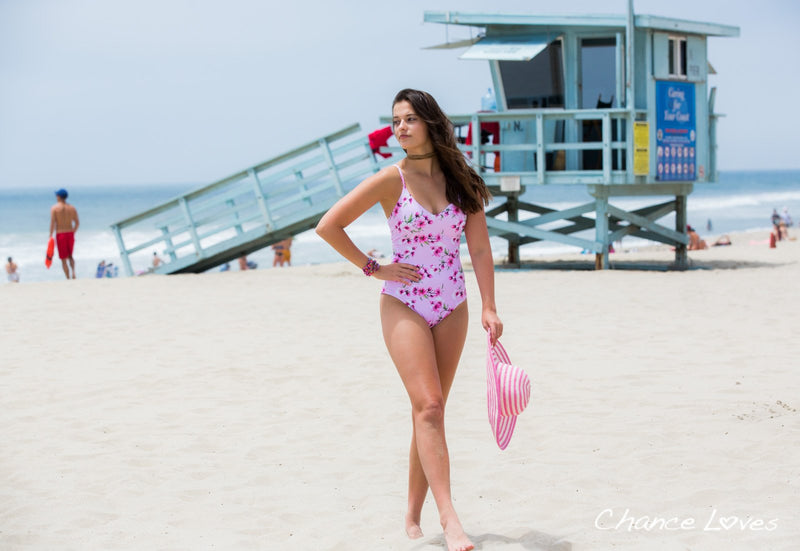 Looking good in Venice Beach in a pink floral One Piece