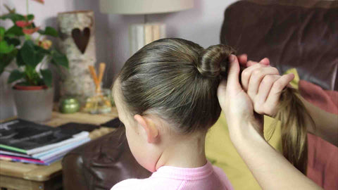 Wrapping the pony tail into a ballet bun
