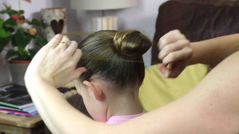 Bring the hairnet down to the bottom of the ballet bun