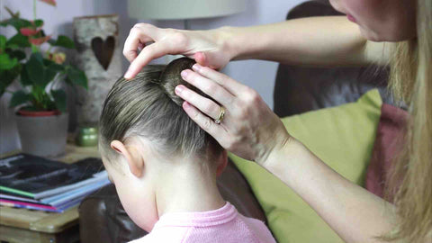 How to secure a ballet bun with hair pins