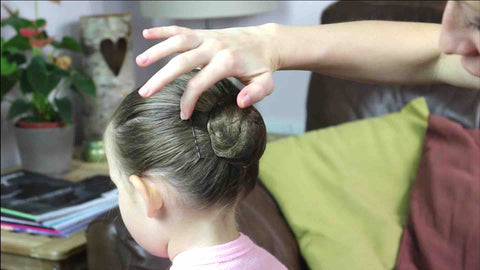 securing your ballet bun with hairgrips