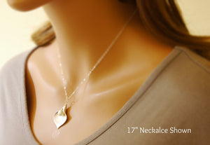 calla lily necklace on a model