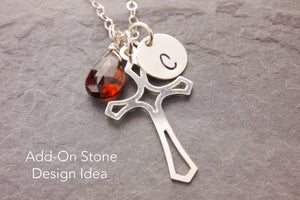 birthstone charm on a cross necklace