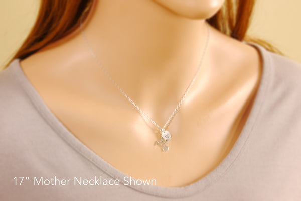 humming bird necklace on a model