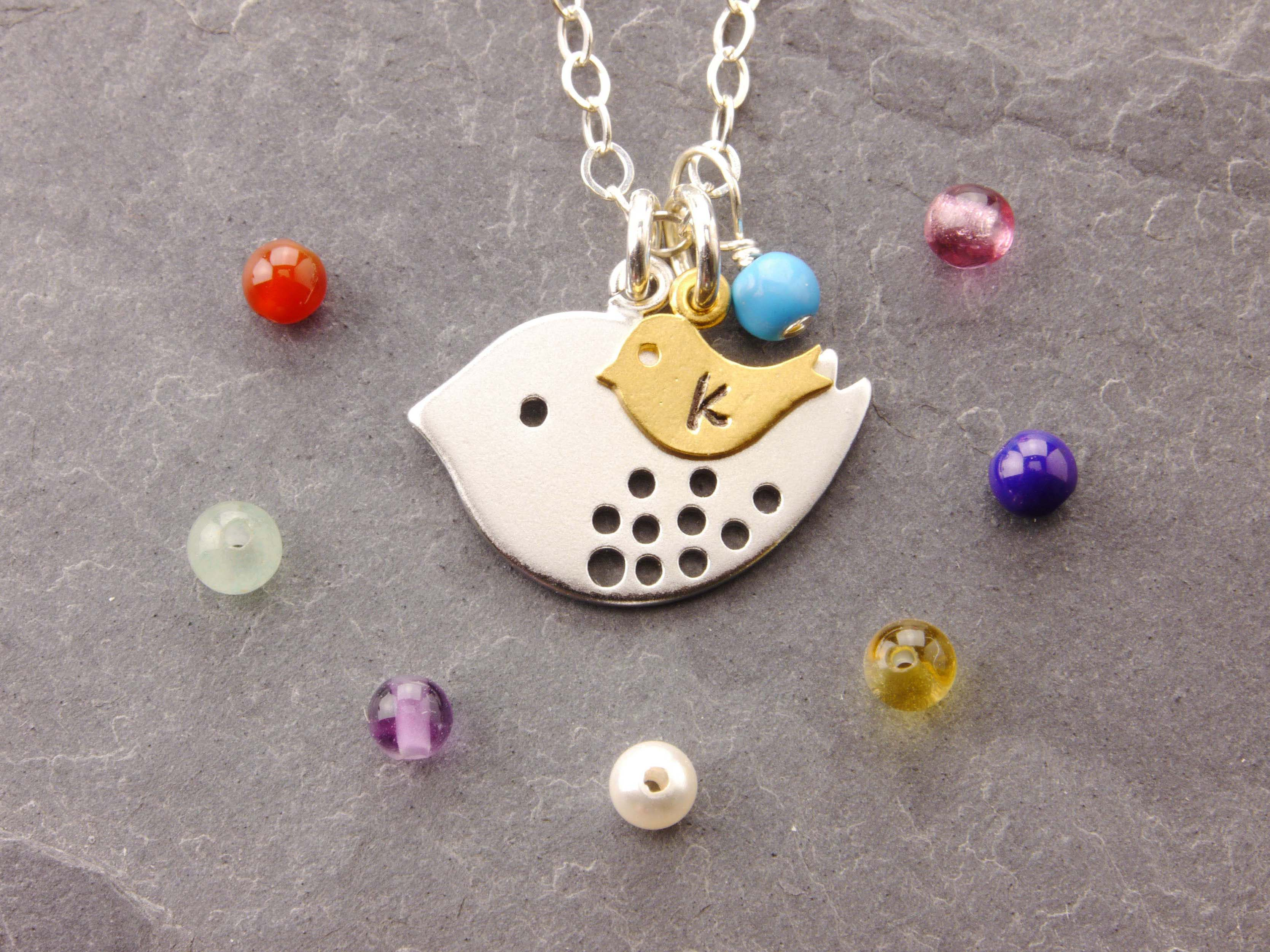 baby on mom necklace