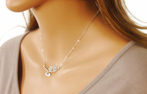 love birds necklace with birthstones on a model