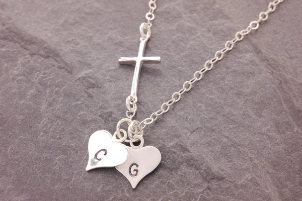 cross necklace with heart charms