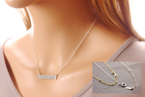 name plate necklace on a model