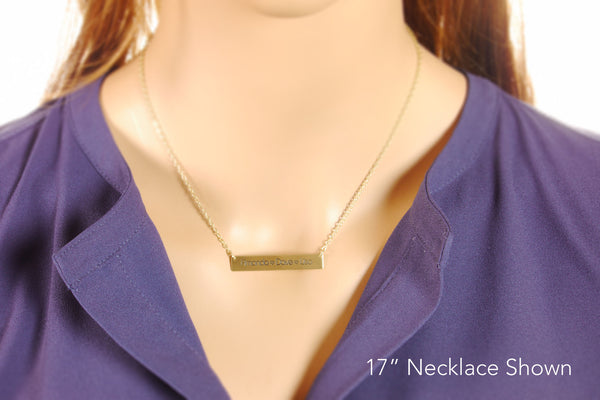 gold bar necklace on a model