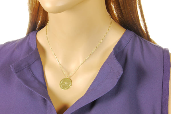 monogram necklace on a model