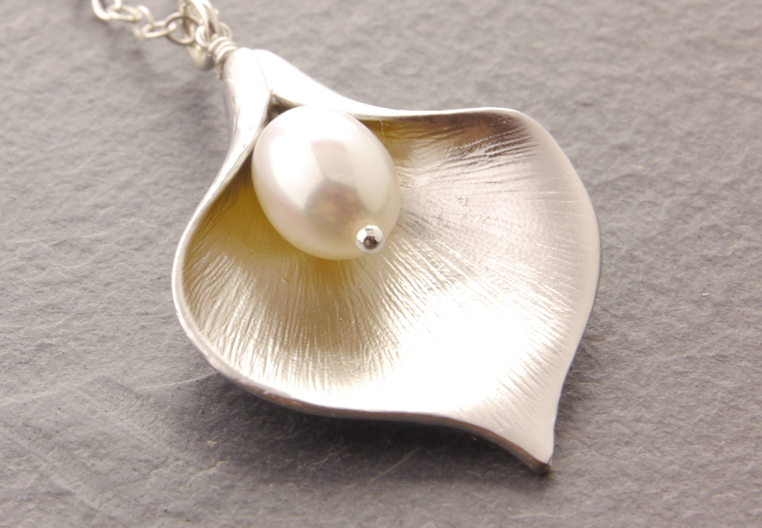 calla lily necklace close up