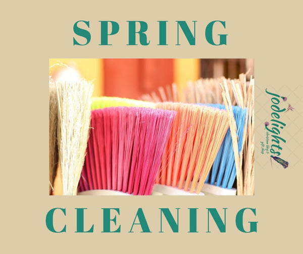 spring cleaning colored brooms