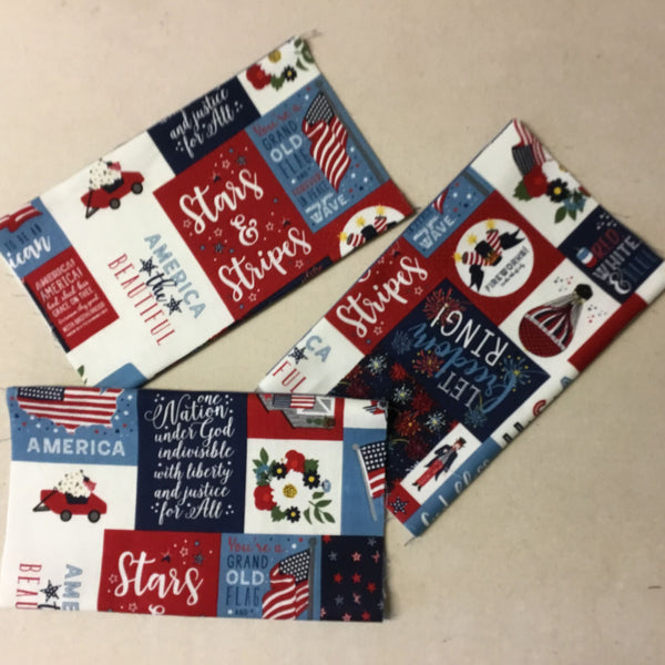 patriotic face mask is a block print in red, white, navy and colonial blue.