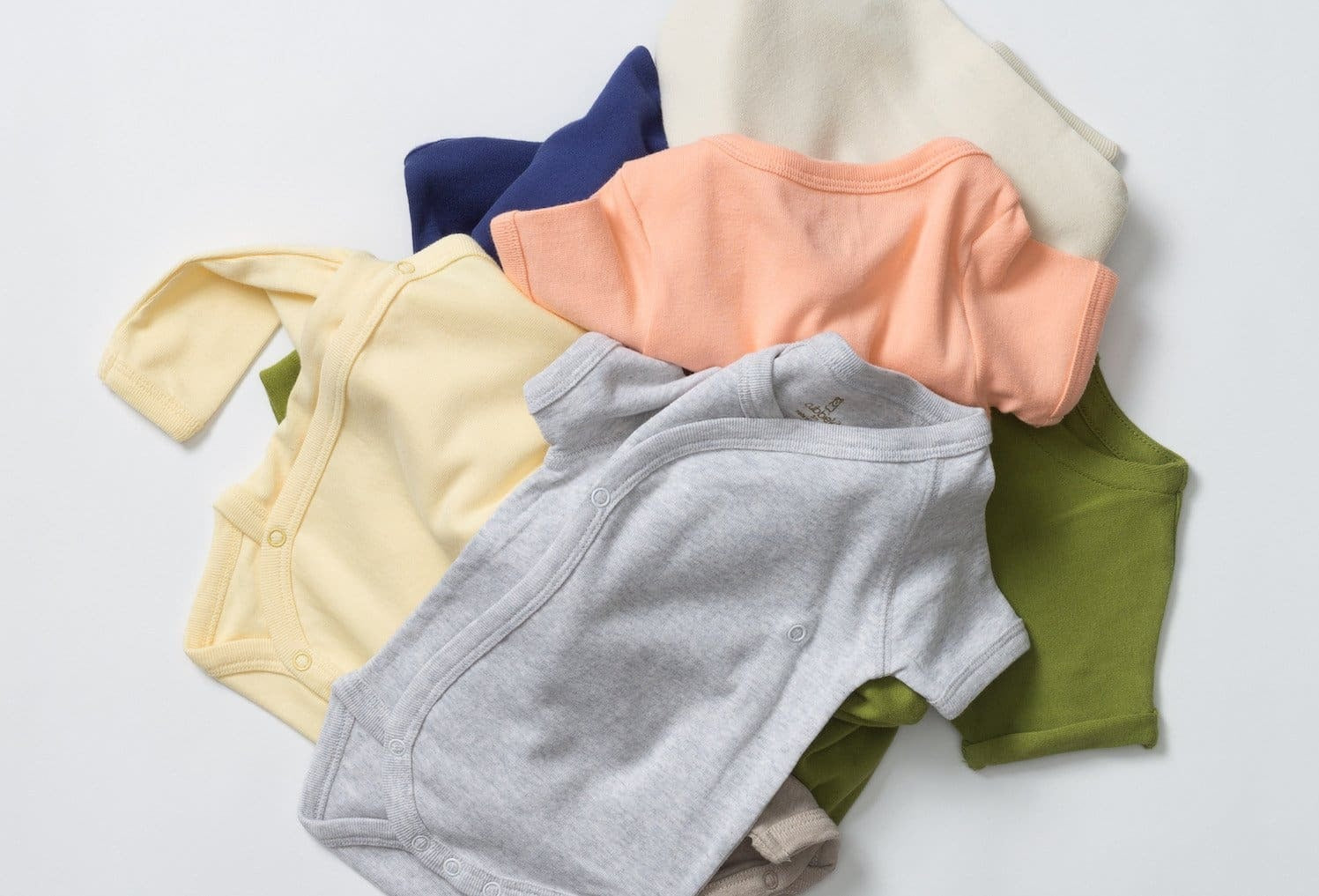 baby clothing in gray, yellow, coral, green, blue, and white