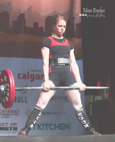 Female Powerlifter Competing