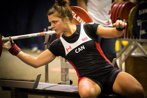 Female Powerlifter Preparing to Lift