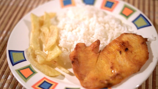 Arroz con pollo and fried yucca.