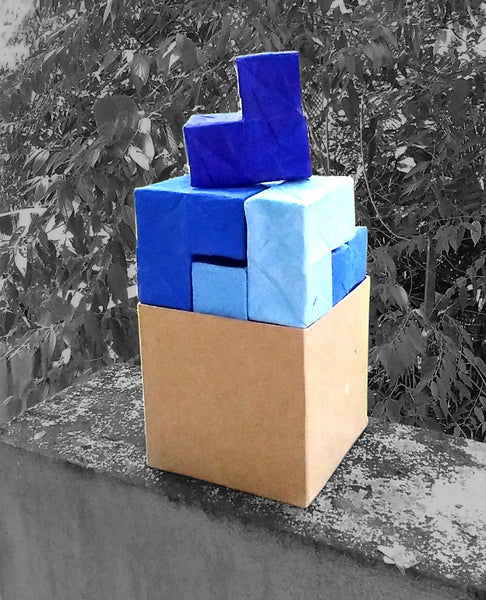 Our rendition of the Soma Cube made with recycled paper.