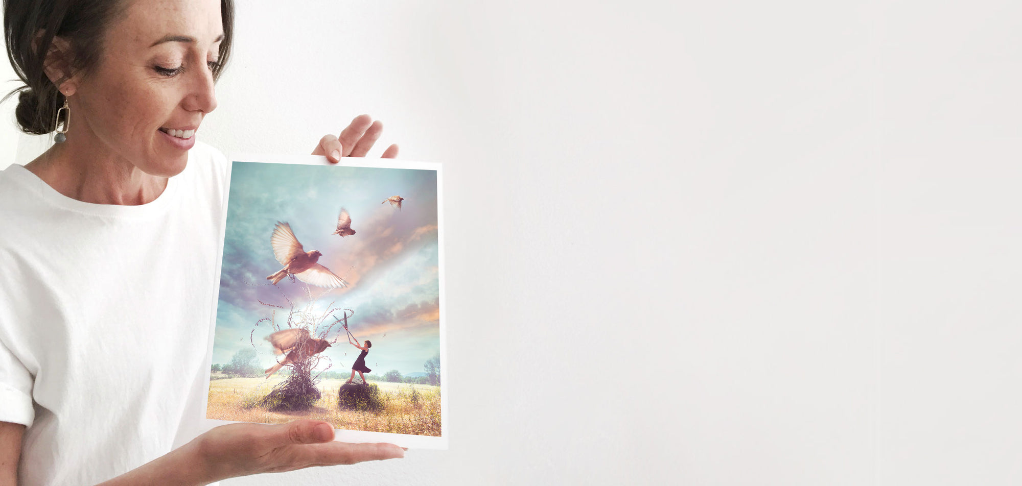 woman holding an fine art photography art print called Letting Go