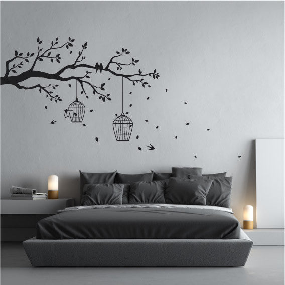 Tree branch wall sticker design with perched birds leaves and bird cages
