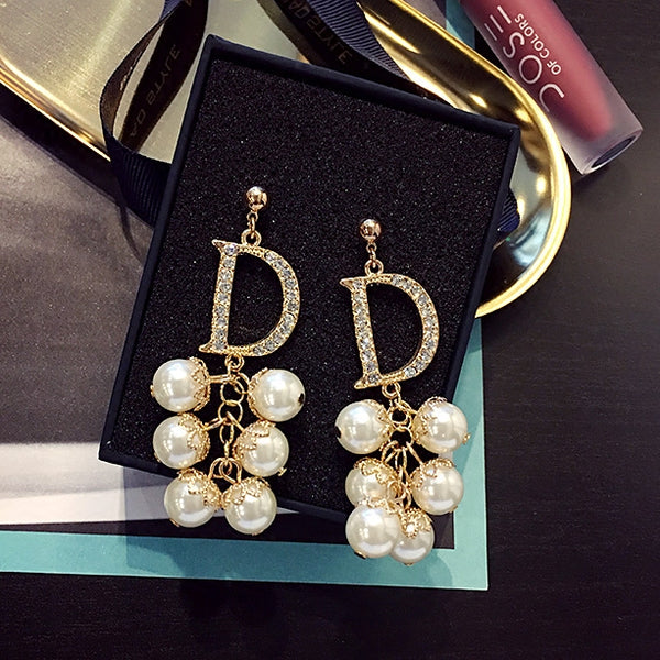 Celebrity pearl earrings CODE: mon1556