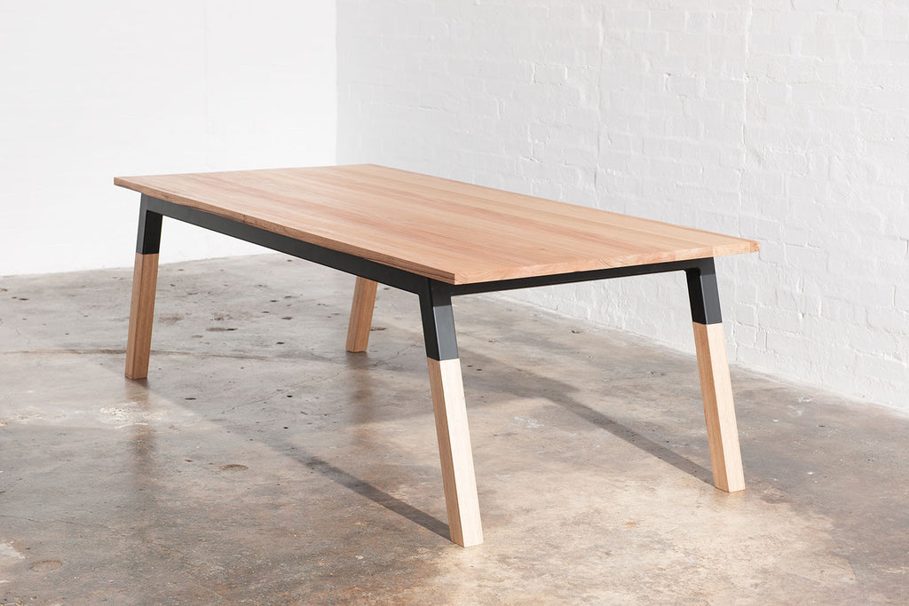 Side view of square leg industrial dining table made from metal and timber.