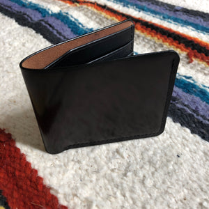 Black vegetable dyed bi fold wallet