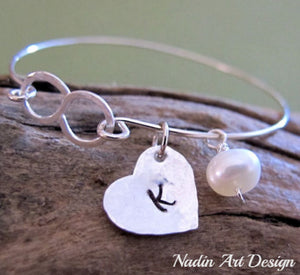 Heart and pearl charm bracelet with infinity symbol