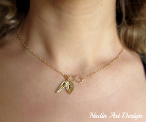 Leaf and feather charms gold necklace