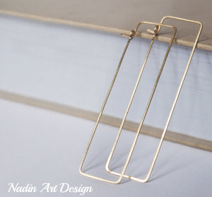 Long rectangular gold hoops