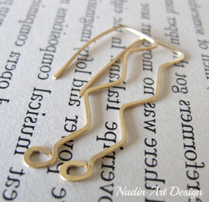 Gold long waves earrings