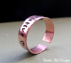 Hammered copper band ring with engraving