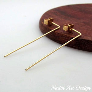 Thread long gold earrings