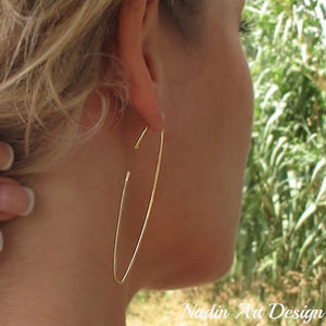 Long gold hoop earrings