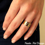 Gold band ring with dog paws