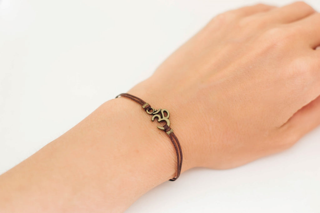 Brown cord bracelet with bronze tone Om charm, for her - shani-adi-jewerly