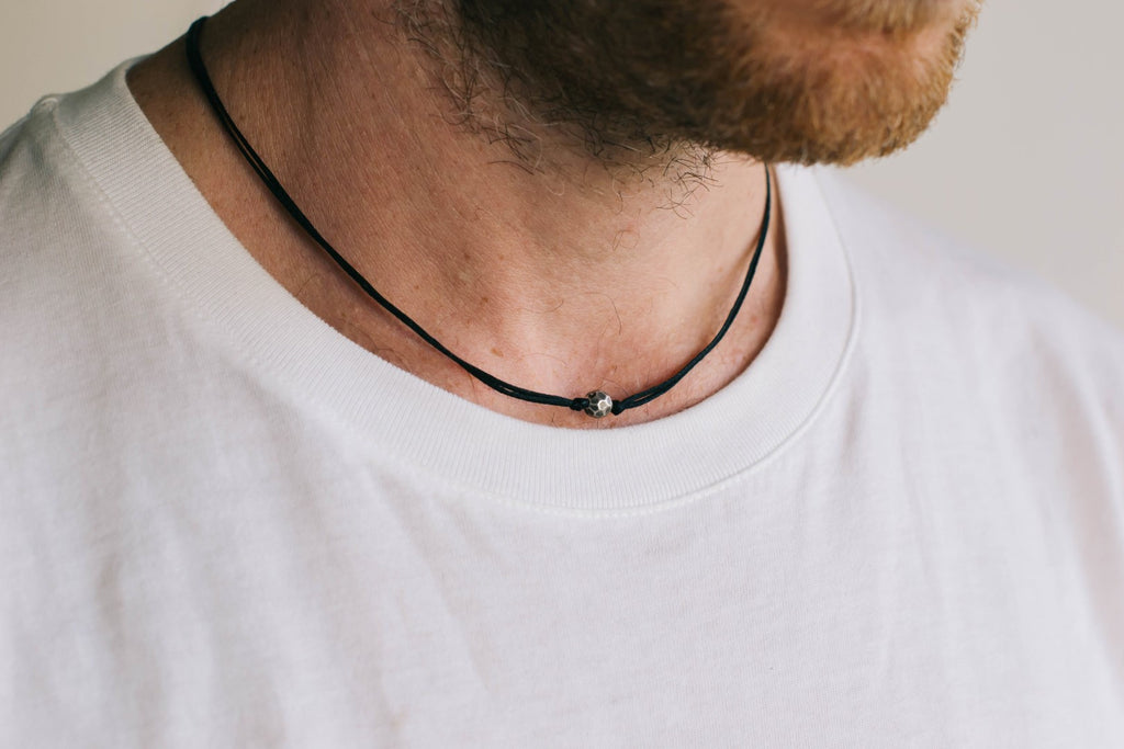 Silver Karma bead necklace for men, black cord