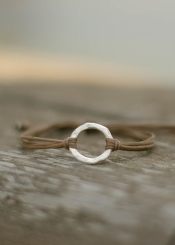 Silver Karma bracelet brown cord adjustable