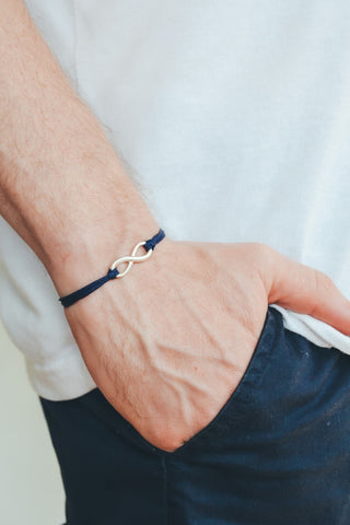 Adjustable silver infinity bracelet for men, blue cord, yoga jewelry