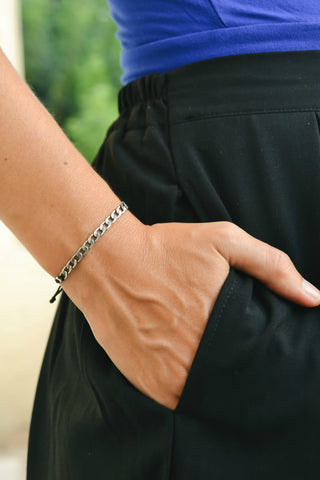 Adjustable cord bracelet with silver flat chain charm, black string